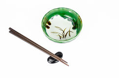 Empty green bowl with chopsticks on white background Stock Photography