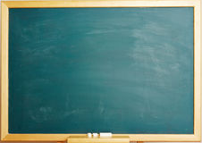 Empty green chalkboard with chalk Royalty Free Stock Photo