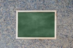 Empty green chalkboard texture hang on the wall. stock images