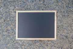Empty green chalkboard texture hang on the wall. stock image