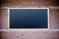 Empty green chalkboard texture hang on the white wall. double frame from greenboard and white background. stock image