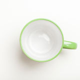 Empty green coffee, tea mug, cup, top view on white Royalty Free Stock Photography