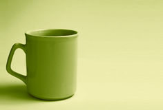 Empty green cup Royalty Free Stock Image