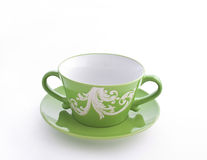 Empty green cup on a saucer Stock Images