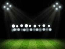 Empty green field with bright lights Stock Photos
