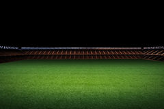 Empty green field with stadium Royalty Free Stock Photography