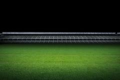 Empty green field with stadium Stock Photos