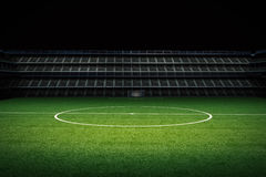 Empty green field with stadium Royalty Free Stock Photos