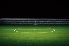 Empty green field with stadium Stock Photo