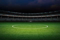 Empty green field with stadium Stock Images