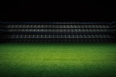 Empty green field with stadium Stock Photography