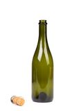 Empty green glass bottle from champagne and cork Royalty Free Stock Photography