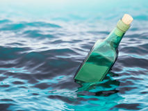 Empty green glass bottle in the sea Stock Image