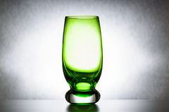 Empty green glass tumbler, abstraction, concept of purity and loneliness Royalty Free Stock Photo