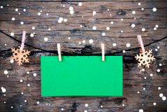 Empty Green Label with Snow on Wooden Background Royalty Free Stock Photo