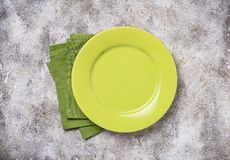 Empty plate on concrete table. Empty green plate on concrete table stock image