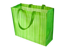 Empty green reusable shopping bag. Isolated on white background stock photography