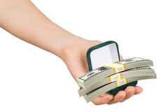 Empty green ring box with money in womans hand Royalty Free Stock Photography