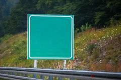 Empty green road sign. On the highway royalty free stock images