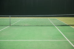 Empty green tennis court Stock Images