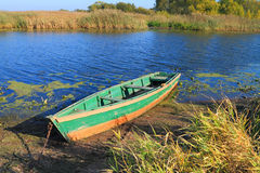 The empty green wooden boat Stock Photo