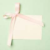 Empty greeting card over a mint green background Royalty Free Stock Image