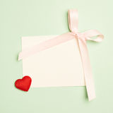 Empty greeting card over a mint green background Stock Photography