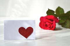 Empty greeting card with red heart on it and a rose Royalty Free Stock Image