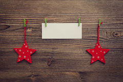 Empty greeting card between xmas stars Royalty Free Stock Photo