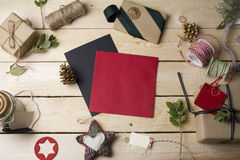 Empty greeting cards and Christmas ornaments on wooden backgroun Stock Image