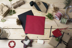 Empty greeting cards and Christmas ornaments on wooden backgroun Royalty Free Stock Photography