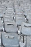 Empty grey chairs Stock Images