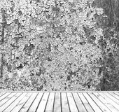 Empty grey grunge wall with wooden plank floor Royalty Free Stock Image
