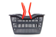 Empty grey shopping basket. With red handles isolated on white background Stock Images