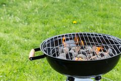Empty grill with fire on garden Royalty Free Stock Image