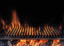 Empty grill grate and tongues of fire flame. Barbeque night background.  royalty free stock images
