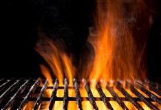 Empty grill grid with fire flames on black Stock Image