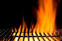 Empty grill grid with fire flames on black Royalty Free Stock Photo