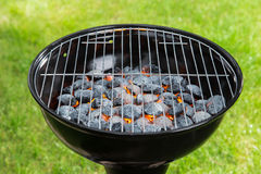 Empty grill with red-hot briquettes. Stock Image