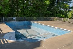 Replacing and repairing old vinyl liner of swimming pool royalty free stock photography