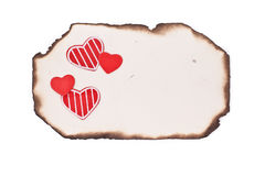 Empty grunge burnt paper and hearts Royalty Free Stock Photo