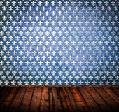 Empty grunge room with blue wall and wooden floor Stock Images