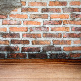 Empty grungy brick wall and wooden floor texture Royalty Free Stock Images