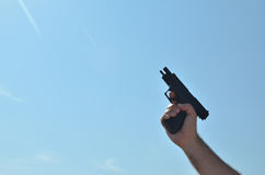 Empty Gun in Hand Stock Image