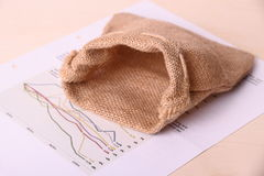 Empty gunny sack on worthless Invest papers Stock Photo