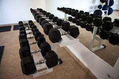 Modern gym interior with various equipment. Empty gym and workout equipment for legs, hands etc Royalty Free Stock Image
