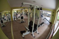 Modern gym interior with various equipment. Empty gym and workout equipment for legs, hands etc Royalty Free Stock Photography
