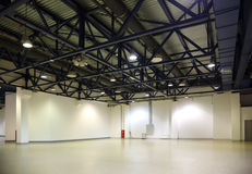 Empty hall. Illumination and ventilating communications under ceiling Stock Photography