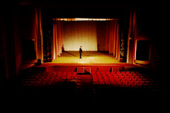 Empty hall. Stock photo: an image of man on the stage in empty hall Royalty Free Stock Photography