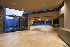 Empty Hall In Modern House. Empty hall in a modern house with view of waterfall through window Stock Photography